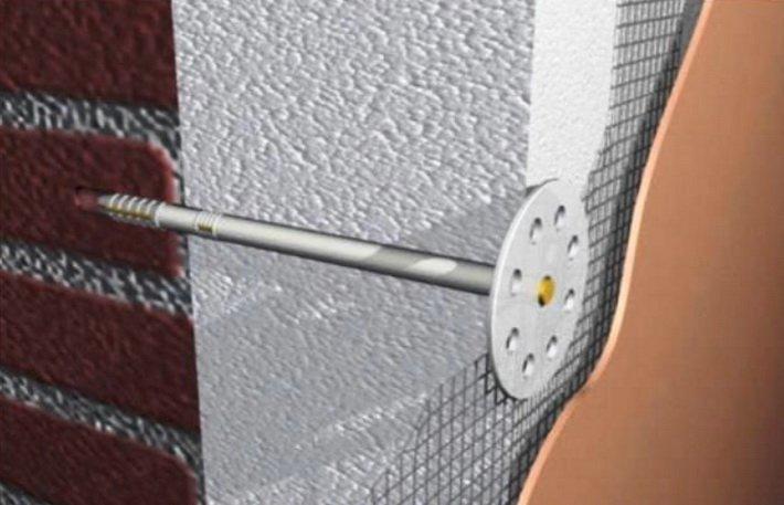 Зонтичный дюбель фиксирует утеплитель на стене