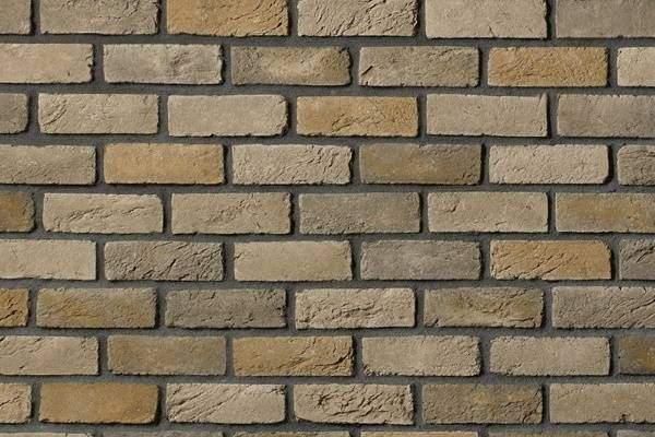 Отделка фасадов камнем под кирпич - варианты и модели